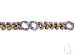 złota bransoletka damska znak nieskończoności cyrkonie złoto żółte14K próba 0.585 prezent