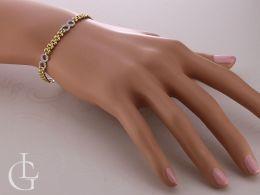 bransoletka ze znakiem nieskończoności na nadgarstku na ręce złoto żółte złoto białe szeroka bransoletka złota złote bransoletki damskie na ręce