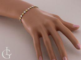 złota bransoletka damska na nadgarstku na ręce czterolistna koniczyna złoto żółte złoto białe próba 0.585 14ct