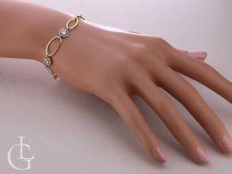 bransoletka damska złota na nadgarstku na ręce złoto żółte cyrkonie kółka kółeczka bransoletki złote na ręce