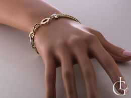 ekskluzywna złota bransoletka damska z białego i żółtego złota 14ct na ręce na nadgarstku