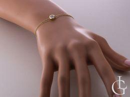 bransoletka złota łańcuszkowa z kółeczkiem cyrkonią na ręce na nadgarstku podwójny złoty łańcuszek
