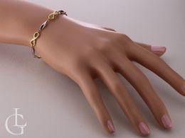 bransoletka złota damska na nadgarstku na ręce ze znakiem nieskończoności gruba szeroka bransoletka