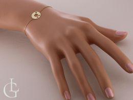 złota bransoletka celebrytka z kołkiem na ręce na nadgarstku bransoletka łańcuszek kółko złoto żółte próba 0.585 bransoletki złote realne zdjęcia na ręce