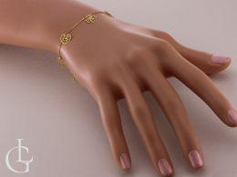 bransoletka złota celebrytka na ręce na nadgarstku przywieszki ażurowe serce czterolistna koniczyna kółko złoto żółte próba 0.585 14ct