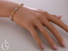 ekskluzywna bransoletka damska zawijana na nadgarstku na ręce złoto żółte złoto białe próba 0.585 14K bransoletki damskie złote różne wzory