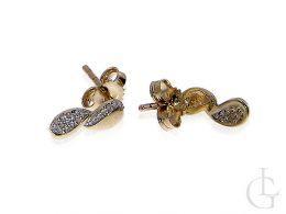 kolczyki złote z brylantami diamentami znak nieskończoności sztyft złoto żółte kolczyki na uchu realne zdjęcie foto
