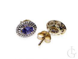 kolczyki złote z brylantami diamentami owalne sztyft złoto żółte kolczyki na uchu realne zdjęcie foto