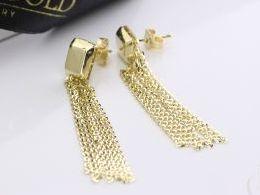 kolczyki złote wiszące łańcuszki łańcuszek sztyft wkręty złoto żółte realne zdjęcia zdjęcie na uchu modelce prezent dla żony dziewczyny