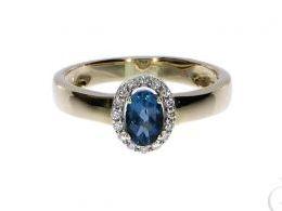 pierścionek złoty zaręczynowy ekskluzywny topaz london blue z topazem z brylantami diamentami brylant diament czarne diamenty czarny diament zaręczyny złoto żółte 14K 0.585 pierścionek na palcu w pudełku realne zdjęcie zdjęcia pierścionek zaręczynowy na r
