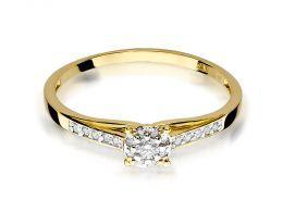 złoty pierścionek klasyczny zaręczynowy z brylantami na szynie i w centralnej części duży brylant złoto żółte 0.585