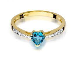 złoty pierścionek zaręczynowy z sercem serce korona z topazem topaz z brylantami brylanty diamenty diament złoto żółte realne zdjęcia na palcu dłoni