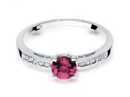 ekskluzywny pierścionek zaręczynowy z białego złota białe złoto z rubinem naturalnym duża ogromna korona brylanty brylant diamenty diament rubin pierścionek na palcu realne zdjęcie foto