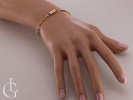 elegancka złota bransoletka kulki na nadgarstku na ręce złoto żółte złoto białe