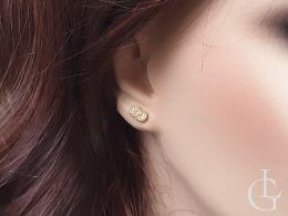 kolczyki złote z cyrkoniami na uchu na wkrętki sztyft złoto żółte próba 0.585 14ct