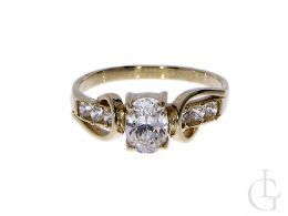 ekskluzywny złoty pierścionek na zaręczyny z klasycznego żółtego złota 14ct próba 0.585