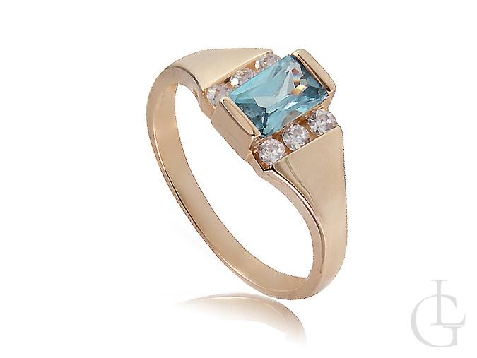 Złoty pierścionek zaręczynowy z topazem i cyrkoniami