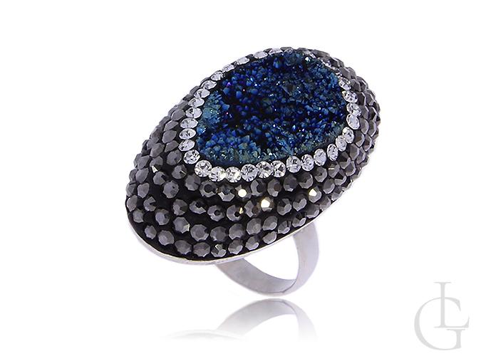 Duży srebrny pierścionek z niebieskim kamieniem