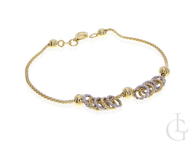 Bransoletka złota z kółeczkami na złotej żyłce