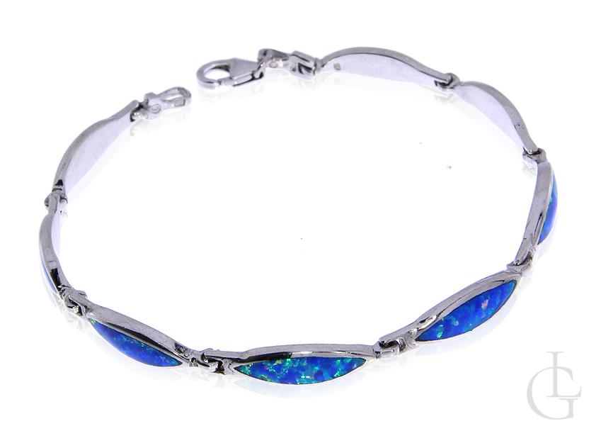 Piękna bransoleta ze srebra rodoanego pr.0,925 z opalem błękitnym