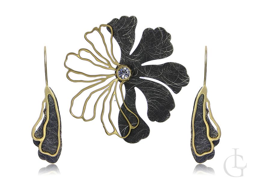 Nowoczesny i designerski komplet biżuterii ze srebra oksydowanego i pozłacanego pr.0,925