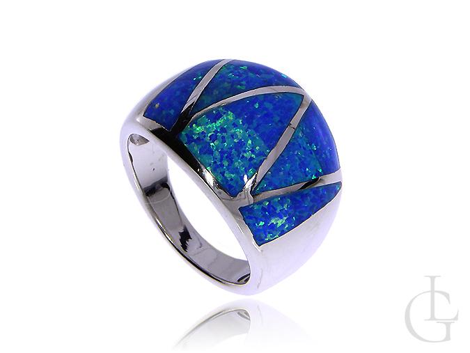 Okazały pierścionek obraczka ze srebra rodowanego pr.0,925 z opalem błękitnym