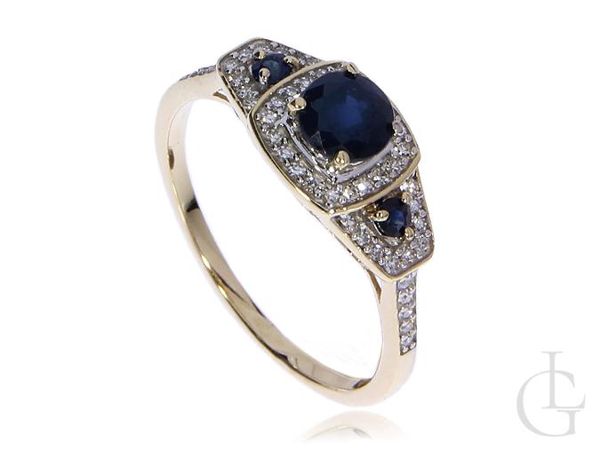 Przepiękny pierścionek złoty pr.0,585 z brylantami i szafirami
