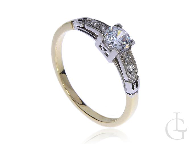 Złoty pierścionek zaręczynowy pr.0,585 z białym złotem