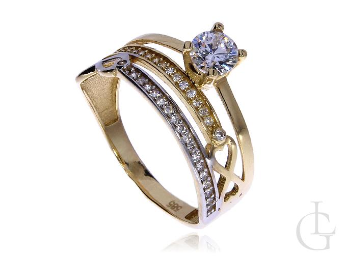 Ciekawy pierścionek obrączka ze złota pr.0,585 z cyrkoniami i znakiem nieskończoności