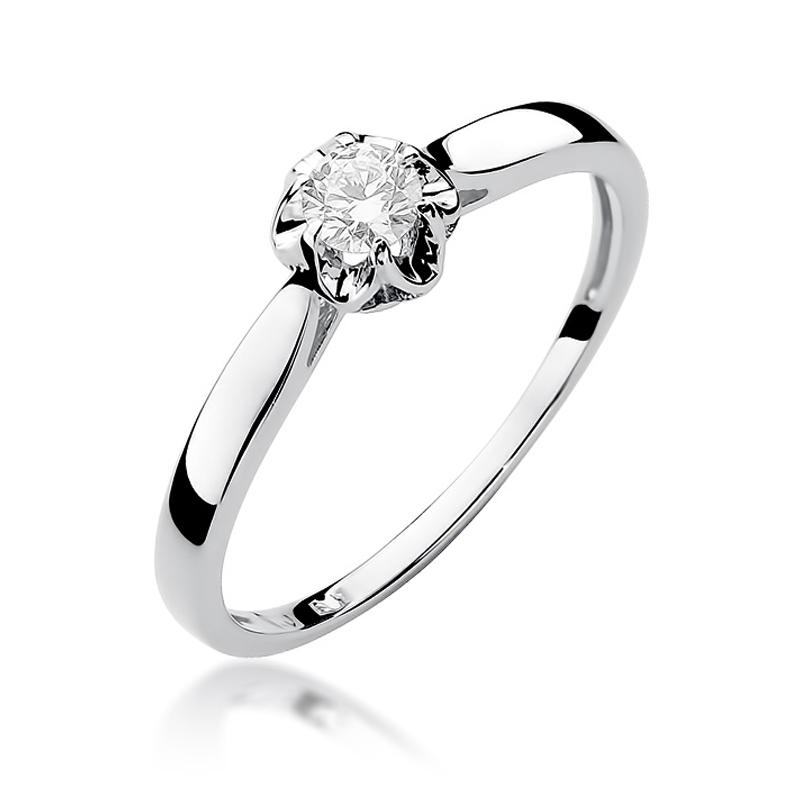 Urokliwy pierścionek zaręczynowy z białego złota pr.0,585 z brylantem