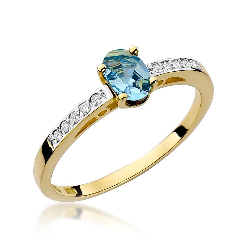 Pierścionek ze złota pr.0,585 z topazem błękitnym i brylantami