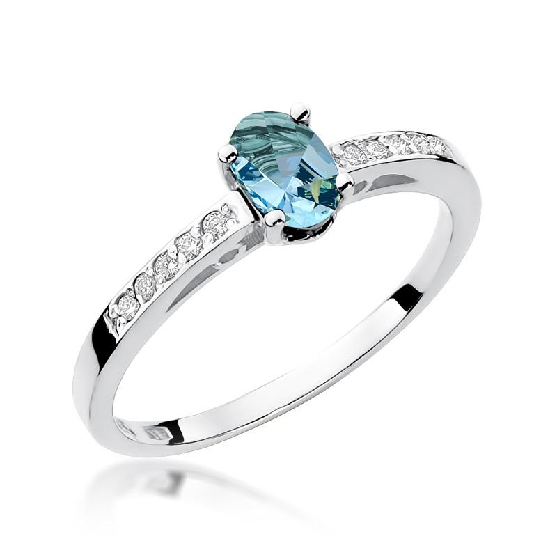 Pierścionek zaręczynowy z białego złota pr.0,585 z topazem błękitnym i brylantami