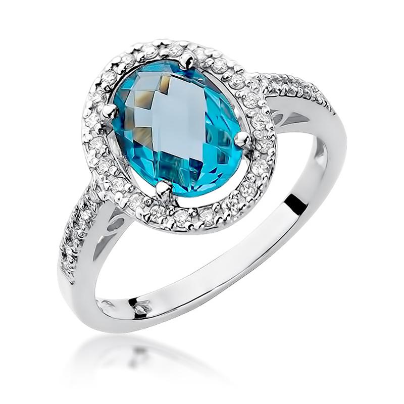 Przepiękny okazały pierścionek z białego złota pr.0,585 z topazem i brylantami