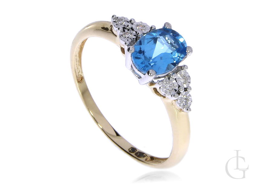 Pierścionek zaręczynowy ze złota pr.0,585 z topazem błękitnym i brylantami
