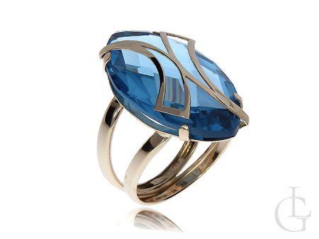 Ekskluzywny duży pierścionek z owalnym topazem błękitnym