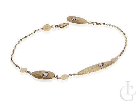 Złota bransoletka łańcuszkowa zdobiona z cyrkoniami