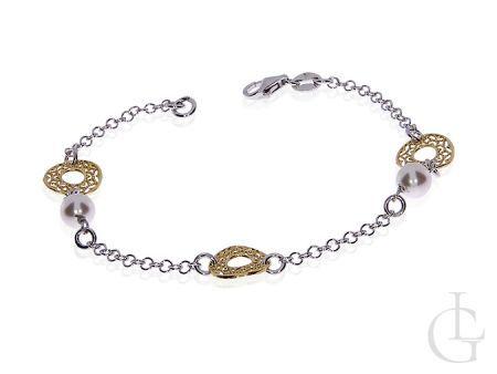 Delikatna srebrna pozłacana bransoletka z perłami i przywieszkami