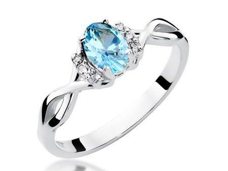 Cudowny pierścionek na zaręczyny z białego złota pr.0,585 z topazem i brylantami