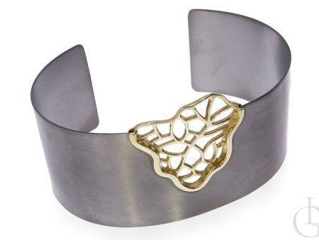 Bransoleta sztywna ze srebra pr.0,925 ze złoceniem