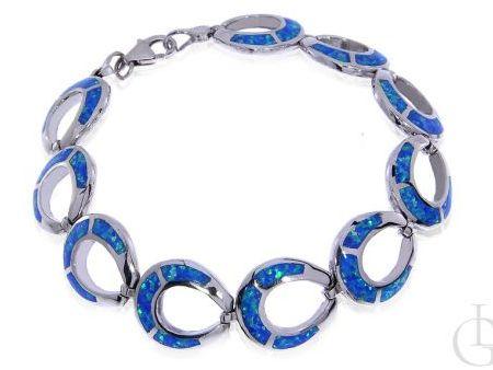 Bransoleta ze srebra rodowanego pr.0,925 z opalem błękitnym
