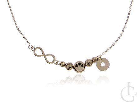 Złoty łańcuszek naszyjnik celebrytka pr.0,585  ze znakiem nieskończoności kółeczkiem i diamentowanymi kulkami