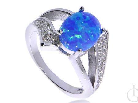 Prześliczny pierścionek ze srebra rodowanego pr.0,925 z opalem błękitnym i cyrkoniami