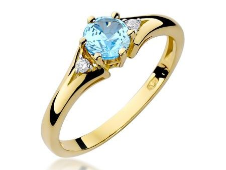 Złoty pierścionek zaręczynowy z brylantami i topazem błękitnym