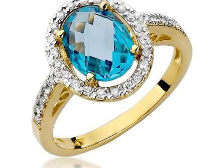 Przepiękny okazały pierścionek ze złota pr.0,585 z topazem i brylantami